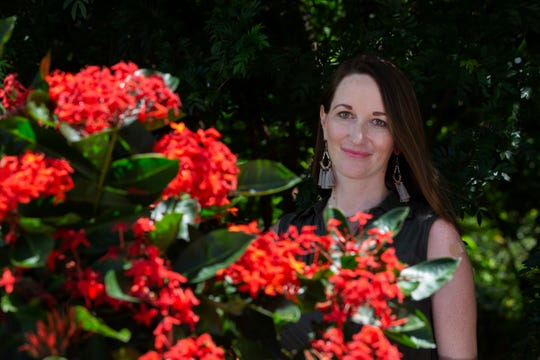 Erin Wolfe Bell, the director of exhibitions, poses for a portrait on Tuesday, August 6, 2019, at the Naples Botanical Garden. The Naples Botanical Garden announced four new leaders last week, who plan to help the garden continue to blossom.