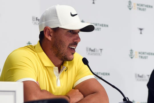 Brooks Koepka talks to the media after his practice round at the Northern Trust Open at Liberty National Golf Course on Wednesday, August 7, 2019, in Jersey City.