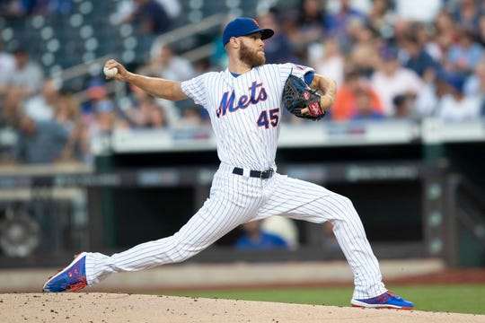 New York Mets starting pitcher Zack Wheeler delivers during the first inning of the team's game against the Miami Marlins, Tuesday, Aug. 6, 2019, in New York.