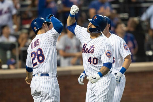 New York Mets' Wilson Ramos (40) celebrates his three-run home run with J.D. Davis (28) during the third inning of the team's game against the Miami Marlins, Tuesday, Aug. 6, 2019, in New York.