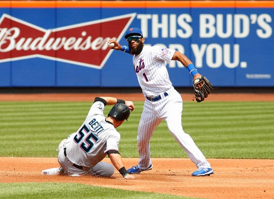 Aug 7, 2019; New York City, NY, USA; Miami Marlins left fielder Jon Berti (55) is forced out at second base by New York Mets shortstop Amed Rosario (1) on the first part of a double play during the first inning at Citi Field. Mandatory Credit: Andy Marlin-USA TODAY Sports