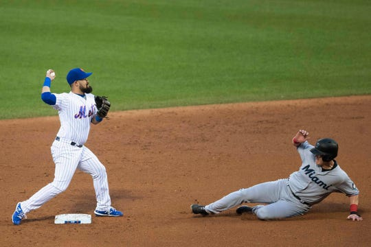 Miami Marlins' Garrett Cooper is forced out at second base by New York Mets' Luis Guillorme during the second inning of a game, Tuesday, Aug. 6, 2019, in New York. Starlin Castro was safe at first.