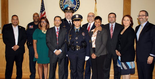 Jessica Funes, center, at her promotion to sergeant in the Haledon police department, March 11, 2015.