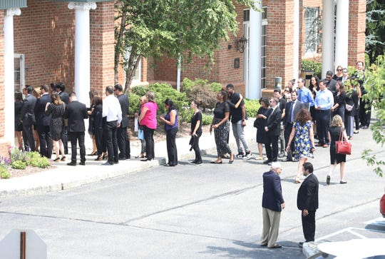 A long line of mourners enter the Bernheim-Apter-Kreitzman Suburban Funeral Chapel on August 7, 2019 in Livingston, NJ to pay respects to David Kimowitz. Kimowitz was stabbed to death on Saturday inside his Maplewood home.