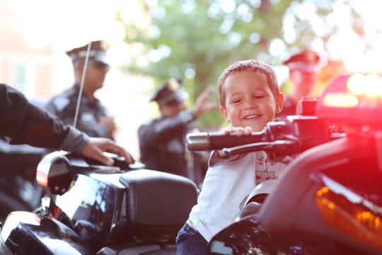 Three-year-old Kaidence Speer had a time of his life when he mounted and revved the motorcycle that belonged New Mexico State Police.