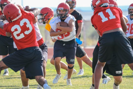 The football team runs drills at the first practice of the school year at Centennial High School in Las Cruces on Tuesday, Aug. 6, 2019.