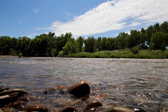 The Animas River is seen, Wednesday, Aug. 7, 2019, in Boyd Park in Farmington.