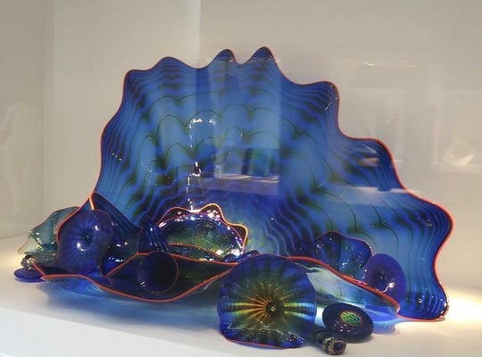 This large blown glass artifact in cobalt blue was made by one of the most famous glass artists in the world, Dale Chihuly. It is about 28 inches tall. When the Glass Family donated their collection, it was one of the finest items.