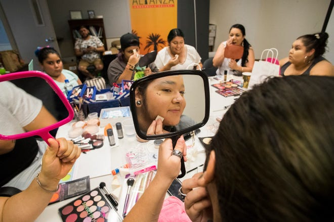 Angel Flores, a teenager, learns the art of putting make-up for drag queen performances