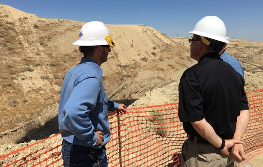 California's acting oil and gas supervisor, Jason Marshall, in black shirt, and Chevron staff at site of massive Cymric 1Y blowout. July 2019