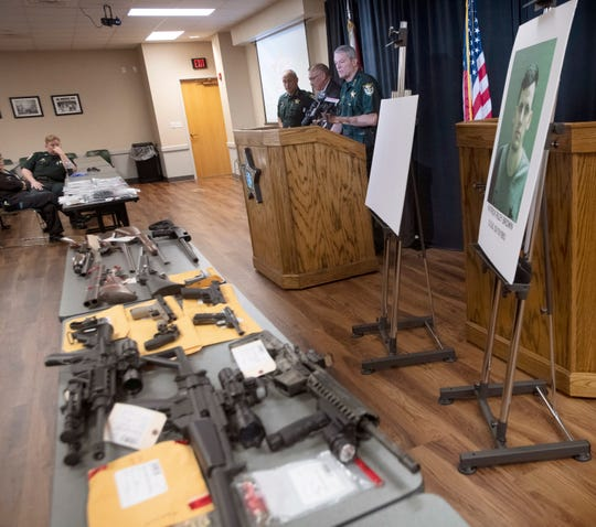 The drugs and illegal firearms seized by Escambia County Sheriff's Office deputies earlier this week during the arrest of a 26-year-old man are displayed during a press conference Wednesday.