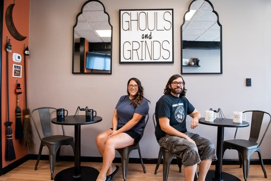 Ghouls and Grinds owner Amber Mitchell poses for a photo with her fiancée Martin Horn on Tuesday, August 6, 2019. Horn is a graphic designer who created the shop's signage.