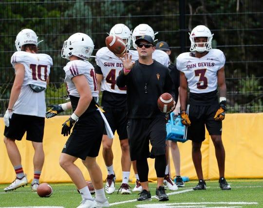 ASU assistant head coach/defensive coordinator Danny Gonzales tosses a ball during practice at Camp Tontozona August 7, 2019.