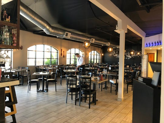 The dining area inside of Los Arbolitos de Cajeme restaurant, a new seafood and steak eatery in Phoenix. This is the Mexican chain's first U.S. location.