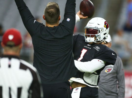 Arizona Cardinals head coach Kliff Kingsbury pressures the pass by quarterback Kyler Murray (1) during training camp on Aug. 6, 2019 in Glendale, Ariz.