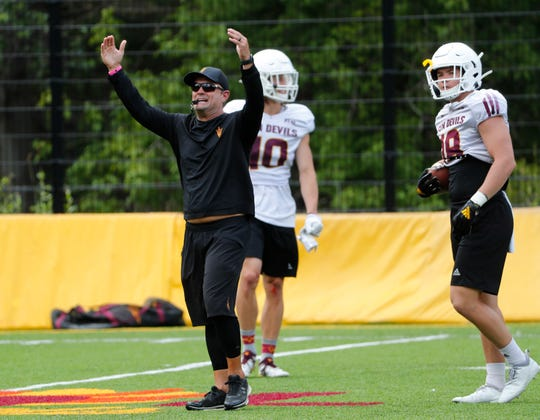 ASU assistant head coach/defensive coordinator Danny Gonzales directs his players during practice at Camp Tontozona August 7, 2019.
