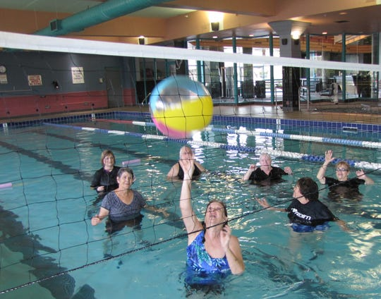 A few of the women who make up the Scottsdale water volleyball team. They spent their one of their last days at the North Scottsdale LA Fitness hitting the beach ball around.