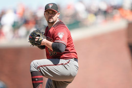Jun 30, 2019: Arizona Diamondbacks pitcher Zack Godley (52) pitches against the San Francisco Giants during the eighth inning at Oracle Park.