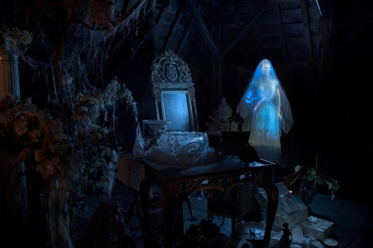Guests touring the Haunted Mansion at Disneyland Park encounter many spooky residents, including the heavily armed Constance Hatchaway, who can be found in the attic as well as featured in the portrait chamber atop her husband's tombstone.