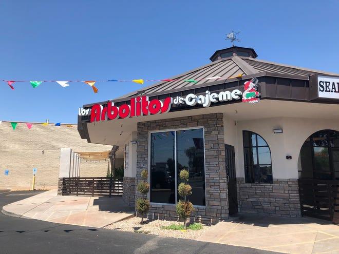 The exterior of Los Arbolitos de Cajeme restaurant in Phoenix. The restaurant serves seafood and steak dishes.