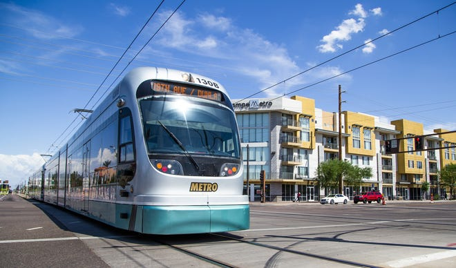 A light rail pulls into the station at McClintock Drive and Apache Boulevard. in Tempe, Wednesday, August 7, 2019.