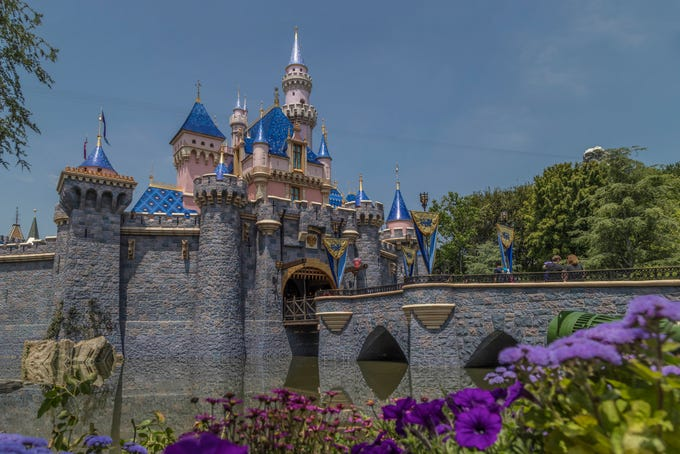 """Sleeping Beauty Castle at Disneyland Park is the centerpiece of Fantasyland, and one of the most recognizable structures in the world. Surrounded by beautiful flowers and whimsical topiary, the Disneyland landmark beckons park visitors to explore the different realms of the place """"Where Dreams Come True."""" (Joshua Sudock/Disneyland Resort)"""