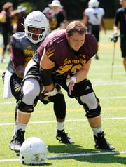 ASU offensive lineman Cade Cote (72) prepares to snap the ball to quarterback Dillon Sterling-Cole (15) during practice at Camp Tontozona August 7, 2019.