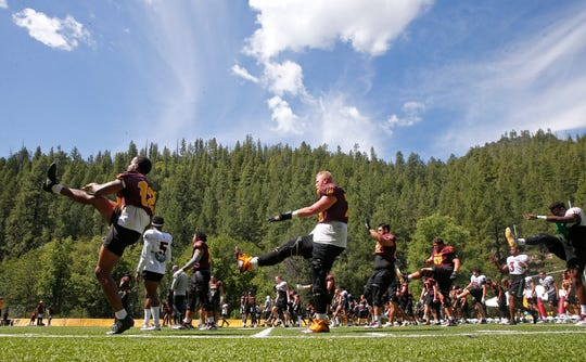 ASU players stretch during practice at Camp Tontozona August 7, 2019.