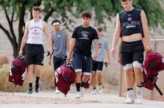 Desert Mountain football players make their way to practice Aug 6, 2019 in Scottsdale, Ariz. (Darryl Webb/For the Republic)