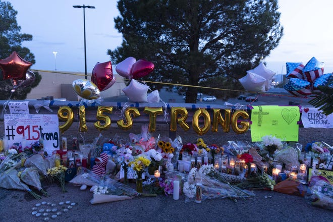 People come to mourn, lay flowers, light candles and pray for victims and their families outside Walmart in El Paso, Texas, on Aug. 6, 2019.