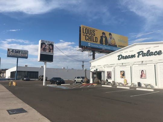 Dream Palace Gentleman's Club and the now-closed 4-Day Furniture are part of a county island along Scottsdale Road just north of Loop 202. XLNT Investments wants to open a medical marijuana dispensary at the 4-day Furniture site.