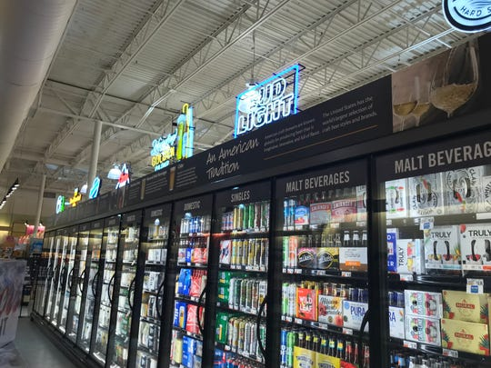 Customers can select from the beer cooler at Giant on Bowman Street in Lebanon.