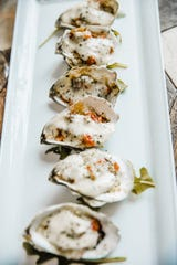 Grilled oysters is one of the signature dishes of Mirbeau Inn & Spa Rhinebeck.