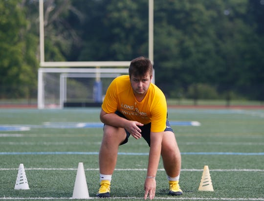 Our Lady of Lourdes football player Jake Timm during his workout on August 7, 2019.