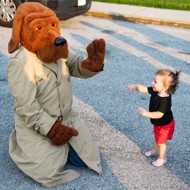 McGruff the Crime Dog gives a high five to one of the younger Night Out participants at the Wellington Community Center in Pennsylvania in 2019.