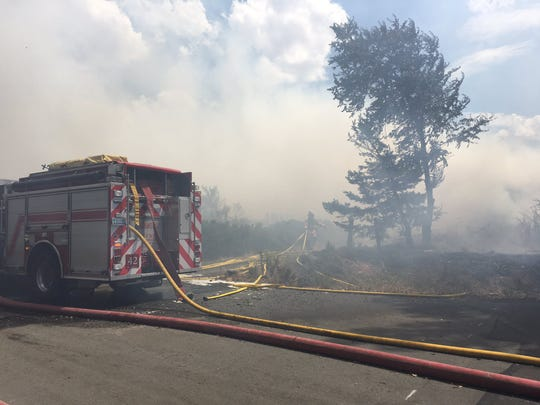 The Truckee Meadows Fire Protection District is battling a brushfire in Cold Springs that has claimed a mobile home.