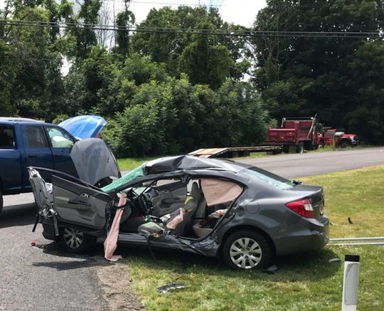 Two people were extricated from a car after a collision on Route 259 in Ogden Wednesday, authorities said.