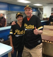 RIT president David Munson and his wife, Nancy, sporting garbage plate baseball jerseys at a recent visit to Nick Tahou Hots in downtown Rochester.