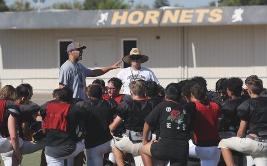 The Enterprise Hornets varsity football team practices Wednesday, Aug. 7, 2019, at Mike Moynahan Field at Enterprise Community Stadium.