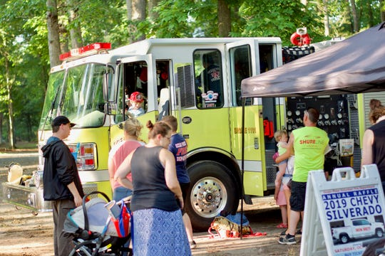 Children check out an Ocean Pines Fire Department truck during the National Night Out event.