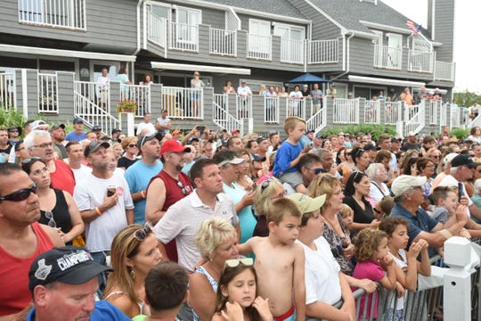 A large crowd waits for fish to be brought in during the third day of the White Marlin Open on Wednesday, Aug. 7, in Ocean City. Spectators were on the lookout for Michael Jordan, whose boat went out on Day 3.