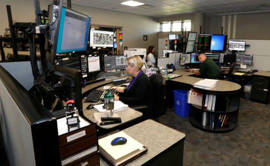 Dispatchers at their work stations at the Sheboygan County Emergency Communications Center, Wednesday, August 7, 2019, in Sheboygan, Wis.