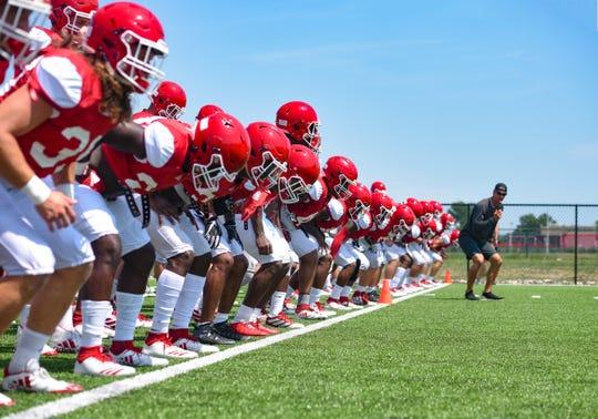 The University of South Dakota football team runs drills on Wednesday, August 7, on the practice field near the Dakotadome in Vermillion.