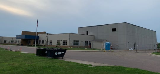 Above is the outside of Frontier Elementary, with the school's newest wing to the right. The expansion is expected to be complete this fall, but weather has been an obstacle, district officials said.