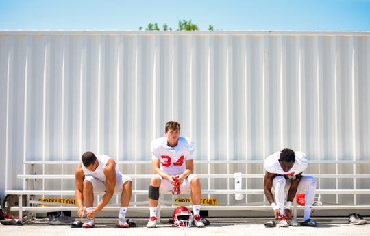 University of South Dakota football players gear up for practice Wednesday, August 7, on the practice field near the Dakotadome in Vermillion.