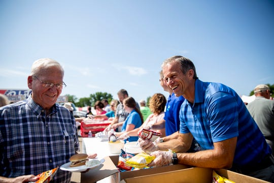Sen. John Thunes serves area farmers and ranchers lunch during Ag Appreciation Day at the Sioux Empire Fair, Wednesday, Aug. 7.