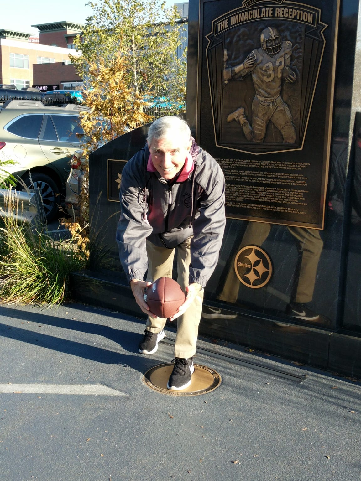 "Mark Line, pictured here at the ""Immaculate Reception"" plaque in Pittsburgh, was a speedy halfback for the 1956 Washington Warriors."