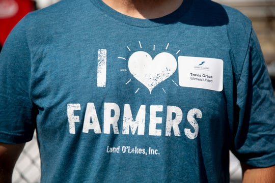 """Volunteer Travis Grace of Winfield United wears a """"I love farmers"""" shirt during Ag Appreciation Day at the Sioux Empire Fair, Wednesday, Aug. 7."""