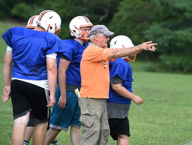 Bill Shirley works with his players on the ACTS Eagles Tuesday afternoon. This is the first year ACTS will be sponsoring tackle football.