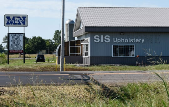 SIS Auto & Furniture Upholstery is pictured Wednesday, Aug. 7, 2019. The business recently settled a lawsuit with the city of St. Augusta concerning storage containers on their property.